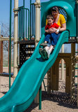 Mom and son play at playground Royalty Free Stock Photography