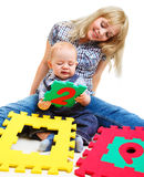 Mom and son playing. With colorful number puzzles Royalty Free Stock Images