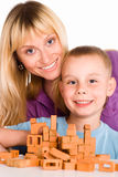 Mom and son playing. Happy mom and her son playing at table Royalty Free Stock Image