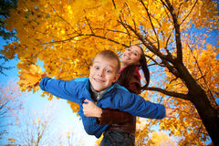 Mom and son are playing in the autumn park Royalty Free Stock Photo