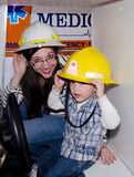 Mom and son playing dress-up Stock Images