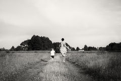 Mom and son playing in the field Royalty Free Stock Photo
