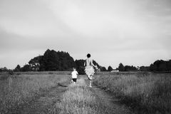 Mom and son playing in the field. Family fun. A beautiful summer day. The joy and fun Royalty Free Stock Images