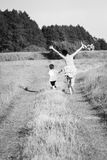 Mom and son playing in the field Stock Photo
