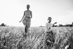 Mom and son playing in the field. Family fun. A beautiful summer day. The joy and fun Stock Images