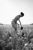 Mom and son playing in the field. Family fun. A beautiful summer day. The joy and fun Royalty Free Stock Photo