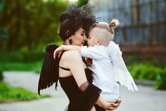 Mom with son playing good and evil. Mom and son playing good and evil. angel vs demon concept Royalty Free Stock Image