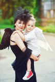 Mom with son playing good and evil. Mom and son playing good and evil. angel vs demon concept Stock Photos