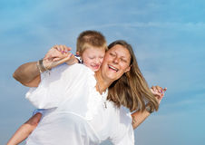 Mom and son are playing happy smiling. A Mom and son are playing happy smiling Stock Images