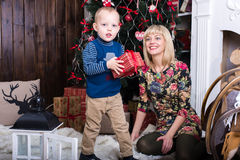 Mom and son playing. Near the Christmas tree Stock Photography