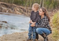 Mother and toddler son relationship. Mom and son playing in the outdoors stock photos