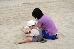 Mom and Son Playing Sand on Beach Royalty Free Stock Images