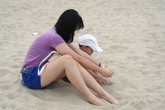 Mom and Son Playing Sand on Beach Royalty Free Stock Photo