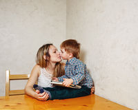 Mom and son playing with a tablet in the kitchen Stock Images