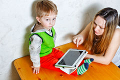 Mom and son playing with tablet PC Royalty Free Stock Image