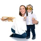 Mom and son are playing with a toy airplane. Mom and son are playing with a toy wooden plane. The concept of a happy childhood, raising a child in the family Royalty Free Stock Photos