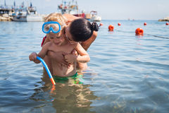Mom and son playing in the water. A lovely summer day. Leisure at sea. The joy of gaming Stock Image