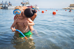 Mom and son playing in the water. A lovely summer day. Leisure at sea. The joy of gaming Royalty Free Stock Photography
