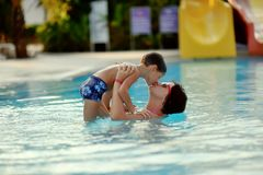 Mom and son in the pool. Mom and son having fun in the summer playing in the pool Stock Photography