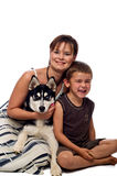 Mom and son posing with dog. Royalty Free Stock Photography