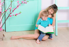 Mom and son reading book indoors Royalty Free Stock Image