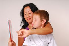 Mom & Son Reading Four Royalty Free Stock Image
