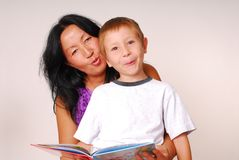 Mom & Son Reading Three Stock Images