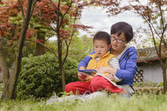 Mom and son reading together Stock Photos