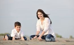 Mom and son relaxing on beach Stock Image