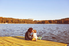 Mom and son resting by the lake Stock Images