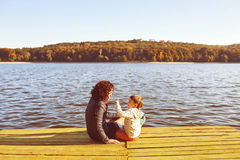 Mom and son resting by the lake Royalty Free Stock Image