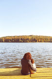 Mom and son resting by the lake Royalty Free Stock Photography