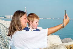 Mom and son are shooting a selfie smiling Royalty Free Stock Images