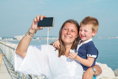 Mom and son are shooting a selfie smiling Stock Image