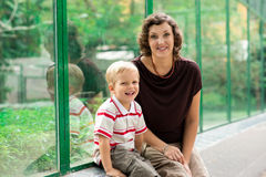 In the zoo. Mom and son sitting in the zoo Stock Image