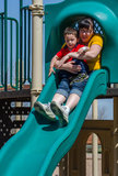 Mom and son on slide Stock Images