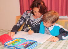 Mom and son studying at home Stock Photo