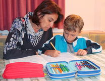 Mom and son studying at home Royalty Free Stock Photos