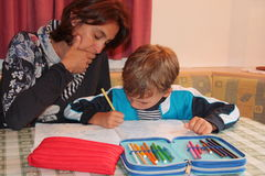 Mom and son studying at home Royalty Free Stock Images