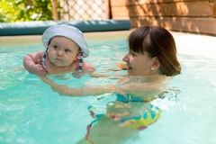Mom and son swimming in the pool Stock Photo