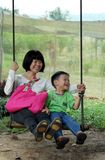 Mom and son on swing set, Happy Family day Stock Photo