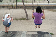 Mom and Son on Swing Set Royalty Free Stock Photography