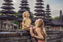Mom and son tourists in Traditional balinese hindu Temple Taman Ayun in Mengwi. Bali, Indonesia Traveling with children. Mom and son tourists in Traditional stock image
