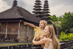Mom and son tourists in Traditional balinese hindu Temple Taman stock photos