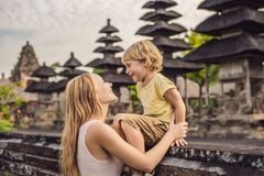 Mom and son tourists in Traditional balinese hindu Temple Taman royalty free stock photography