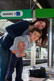 Mom and son in the train station Stock Images