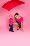 Mom and son under a red umbrella Royalty Free Stock Images