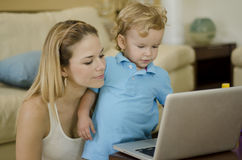 Mom and son using a laptop Stock Photos