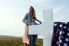 Mom and son visited the grave of the father on the memorial day 27 may.  stock images