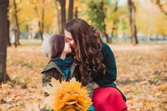 Mom and son walk in the autumn Park. Happy family. Autumn concept. royalty free stock photography